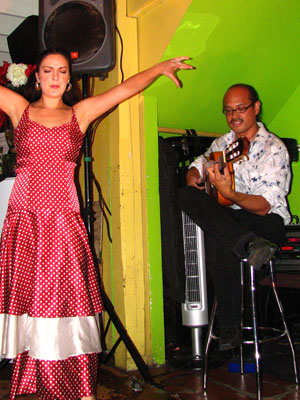 Flamenco dancer Sara Jerez in a red dress with white polka dots and guitarist Miguelito at Cafe Citron