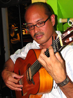 Flamenco guitarist Miguelito warming up at Cafe Citron