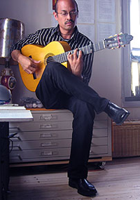 Flamenco guitarist Miguelito practicing at home